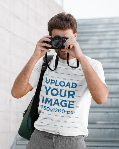 T-Shirt Mockup of a Man Taking a Picture with a Camera 42269-r-el2