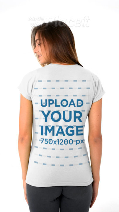 Back-View T-Shirt Video of a Woman Standing in a Studio 43759v