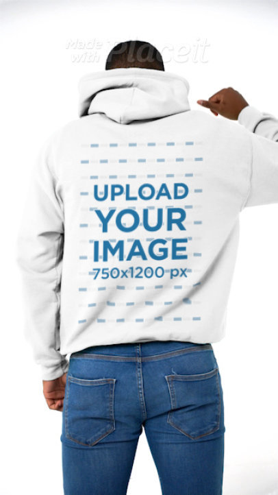 Back-View Hoodie Video of a Man Posing Against a Solid Surface 43762v