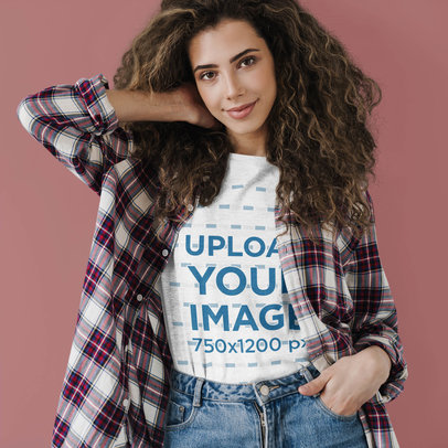 Basic T-Shirt Mockup of a Curly-Haired Woman Posing Against a Colored Backdrop 46112-r-el2
