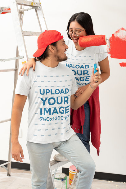 T-Shirt Mockup Featuring a Young Couple Painting Their Apartment's Wall m1072