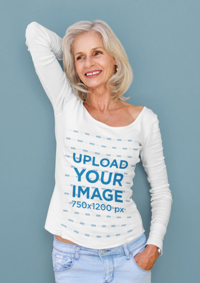 Long-Sleeve Tee Mockup Featuring a Happy Senior Woman Leaning Against a Solid Color Wall 34811-r-el2
