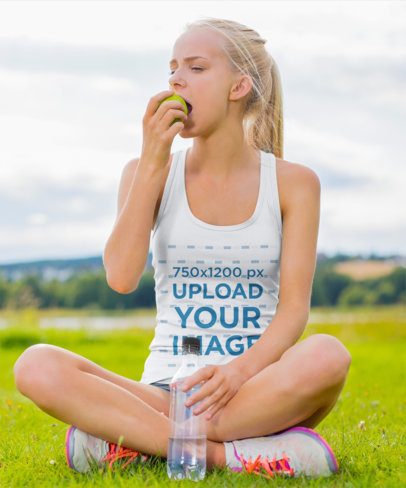Tank Top Mockup Featuring a Woman Eating an Apple at a Park 35580-r-el2