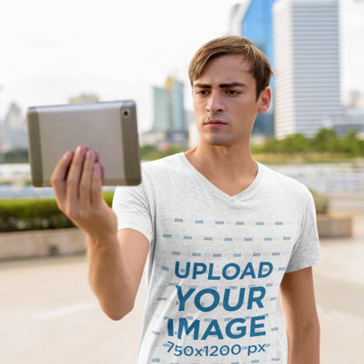 V-Neck Tee Mockup of a Serious Man Holding a Tablet 44423-r-el2