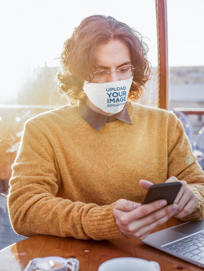 Face Mask Mockup of an Intellectual-Looking Man Using His Smartphone 46692-r-el2