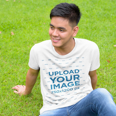 T-Shirt Mockup Featuring a Smiling Man Sitting on Grass 44388-r-el2