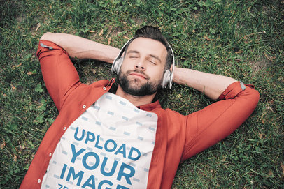 T-Shirt Mockup of a Relaxed Man Lying on the Grass with Headphones 46926-r-el2