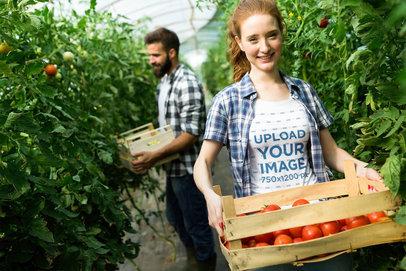 T-Shirt Mockup of a Happy Woman Carrying a Tomato Box 42568-r-el2