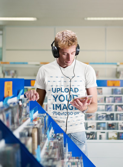 T-Shirt Mockup Featuring a Man Listening to Music at a Record Store 39536-r-el2