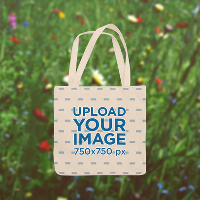 Tote Bag Mockup Featuring a Spring-Themed Background m1419