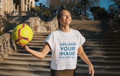 T-Shirt Mockup Featuring a Happy Woman Holding a Soccer Ball 42034-r-el2