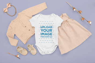 Onesie Mockup Featuring a Girl's Outfit in a Flat Lay Style M1138