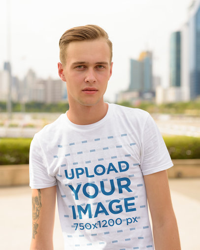 Basic T-Shirt Mockup of a Serious Young Man With an Arm Tattoo 44418-r-el2