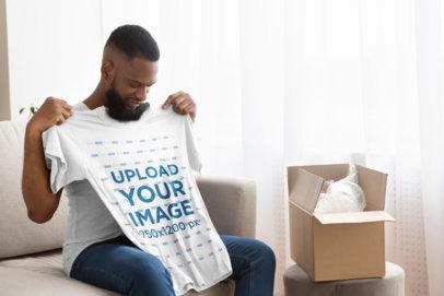 Mockup of a Man Unpackaging a New T-Shirt 39564-r-el2