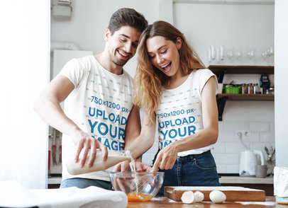 T-Shirt Mockup Featuring a Couple Mixing the Batter 40353-r-el2
