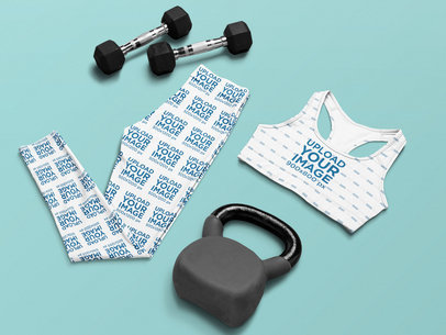 Sports Bra and Leggings Mockup Featuring a Kettlebell and Dumbbells m1205