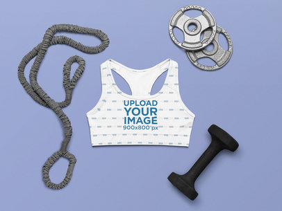 Mockup of a Sublimated Sports Bra Placed Among Fitness Accessories m1203