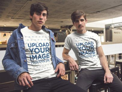 Two Guys Wearing a T-Shirt Mockup Hanging Out at a Bar a15316