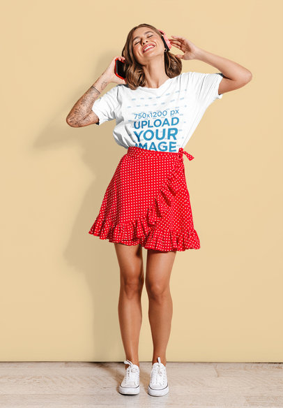 T-Shirt Mockup of a Happy Woman Listening to Music Against a Colored Backdrop 39844-r-el2