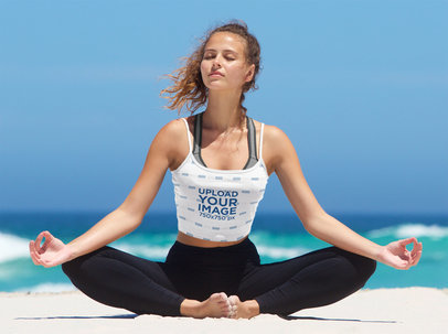 Mockup of a Woman Wearing a Tank Top While Meditating by The Sea 34883-r-el2