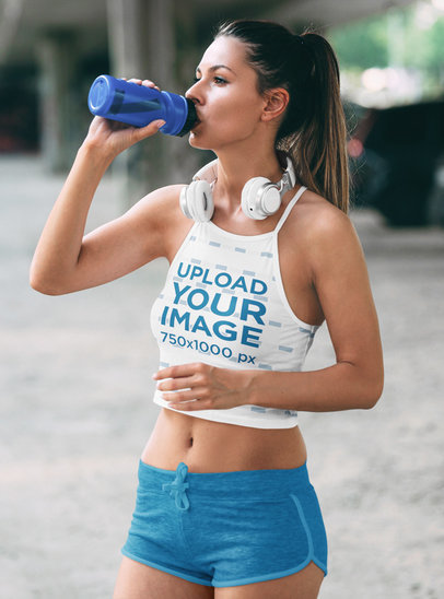 Activewear Mockup of a Woman Wearing a Sublimated Crop Top and Drinking Water 41221-r-el2