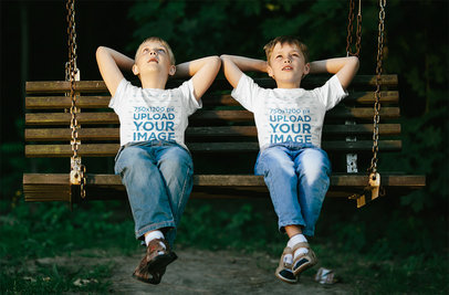 T-Shirt Mockup Featuring Two Brothers Hanging Out on a Swinging Bench 35672-r-el2