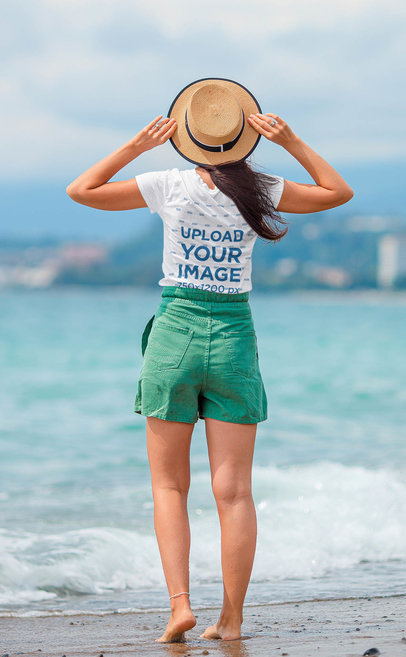 Back-View T-Shirt Mockup Featuring a Woman at the Beach 43857-r-el2