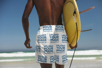 Back-View Swim Trunks Mockup of a Surfer at the Beach 40979-r-el2