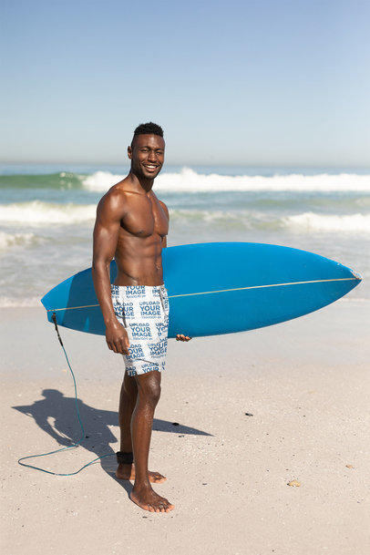 Swim Trunks Mockup of a Happy Man Holding a Surf Board 40981-r-el2