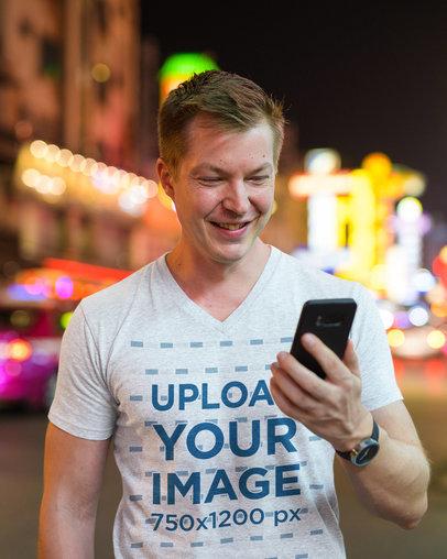 V-Neck T-Shirt Mockup of a Happy Man in the City at Night 42746-r-el2