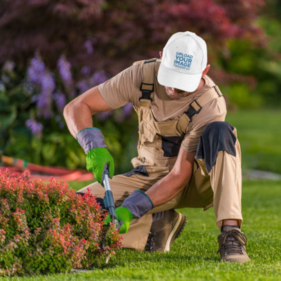 Dad Hat Mockup Featuring a Gardener Working on a Small Bush 42096-r-el2