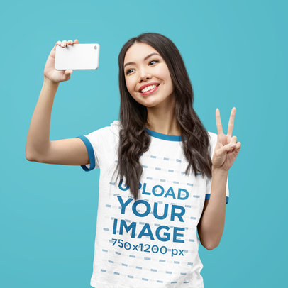 Ringer T-Shirt Mockup Featuring a Happy Woman Posing Against a Solid Color Backdrop 40709-r-el2