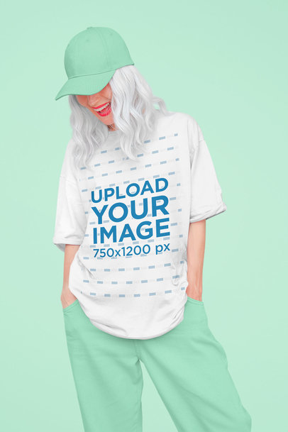 Mockup of a Happy Woman Wearing an Oversized T-Shirt at a Studio 43090-r-el2
