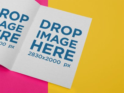 Open Booklet Mockup Lying on a Two Colors Surface a15126