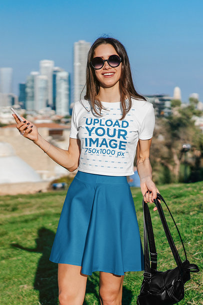 Crop Top Mockup Featuring a Woman Posing Against a Big City Setting 39763-r-el2