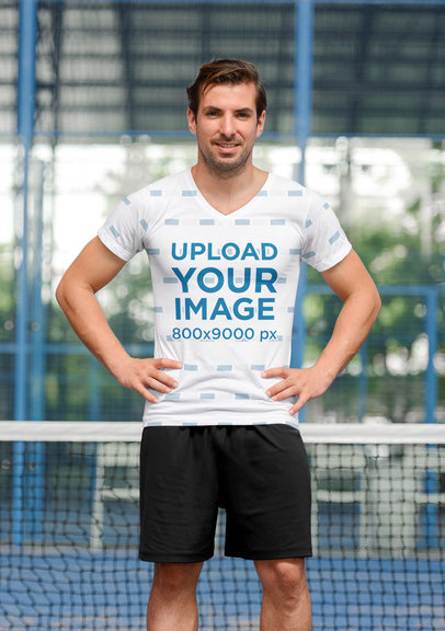 Mockup of  an Athletic Man Wearing a Sublimated V-Neck Tee in a Tennis Court 41415-r-el2