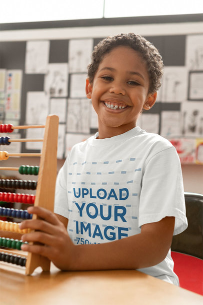 T-Shirt Mockup of a Happy Kid Holding an Abacus 40504-r-el2