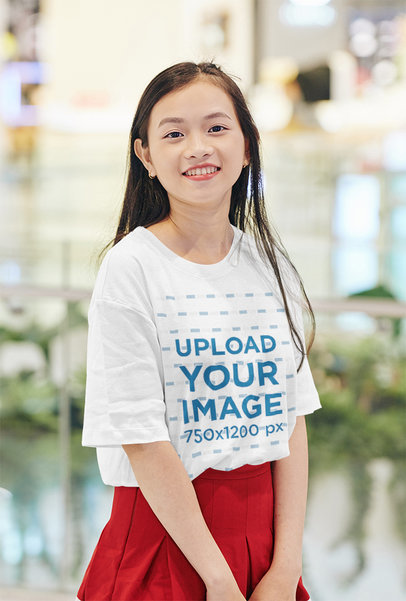 Mockup of a Woman Wearing an Oversized T-Shirt at a Mall 44456-r-el2