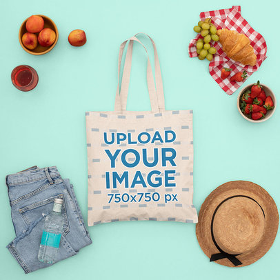 Mockup of a Tote Bag Surrounded by Summer Garments and Fresh Fruits m1669
