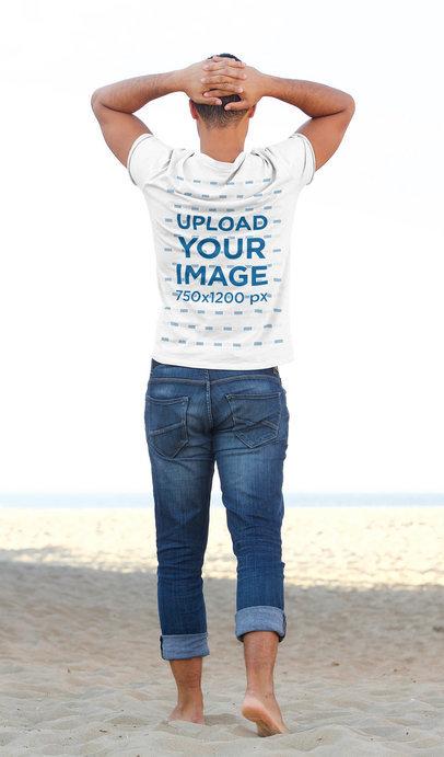 T-Shirt Mockup of a Man Walking Towards the Sea 43852-r-el2