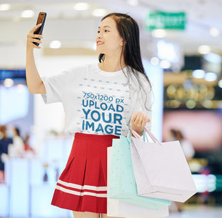 T-Shirt Mockup of a Woman Taking a Selfie While Shopping 44458-r-el2