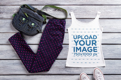 Mockup of a Tank Top Placed on a Wooden Surface Among Other Garments 39758-r-el2