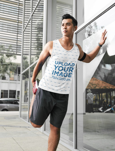 Tank Top Mockup of an Athlete Stretching His Leg Before Running Through the City 42052-r-el2
