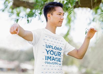 T-Shirt Mockup Featuring a Man Doing Outdoor Tai Chi 44404-r-el2