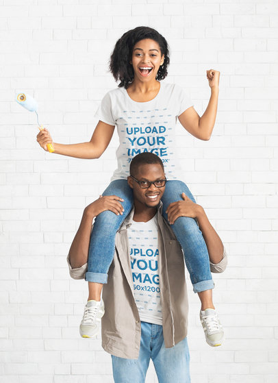 T-Shirt Mockup Featuring a Woman Sitting on Her Boyfriend's Shoulders 40216-r-el2