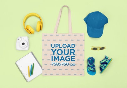 Mockup of a Tote Bag with Kid's Items for a Summer Trip m1263