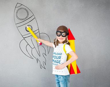 T-Shirt Mockup of a Girl in a Pilot Costume Drawing a Rocket 43084-r-el2