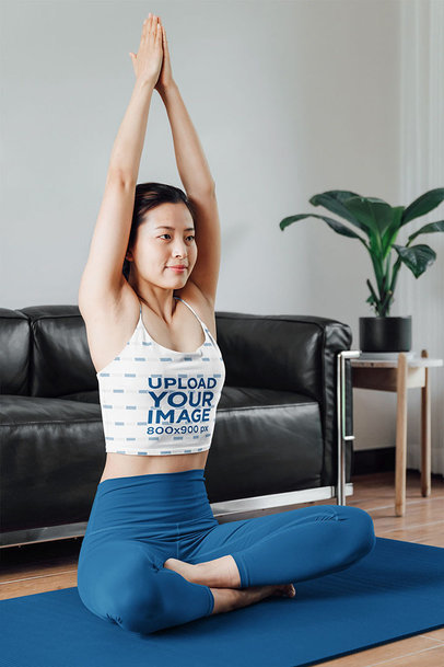 Mockup of a Young Woman Doing Yoga at Home While Wearing a Tank Top 42200-r-el2