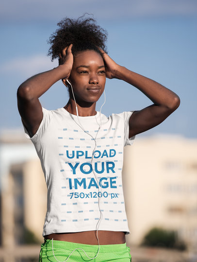 T-Shirt Mockup of a Woman Listening to Music Before an Outdoor Run 45366-r-el2