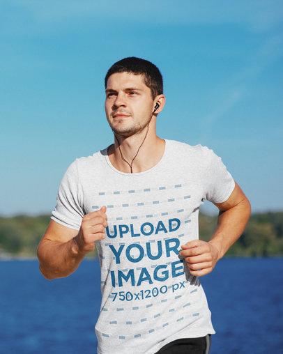 T-Shirt Mockup of a Young Man Running by a Lake 44814-r-el2